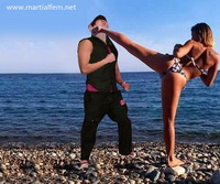 57 - Bikini karate woman beats male oponent